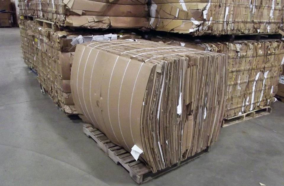 cardboard boxes flattened and wrapped into a large bundle