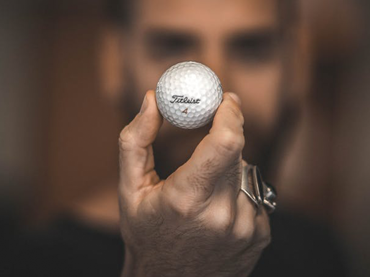 golf gall held in a hand