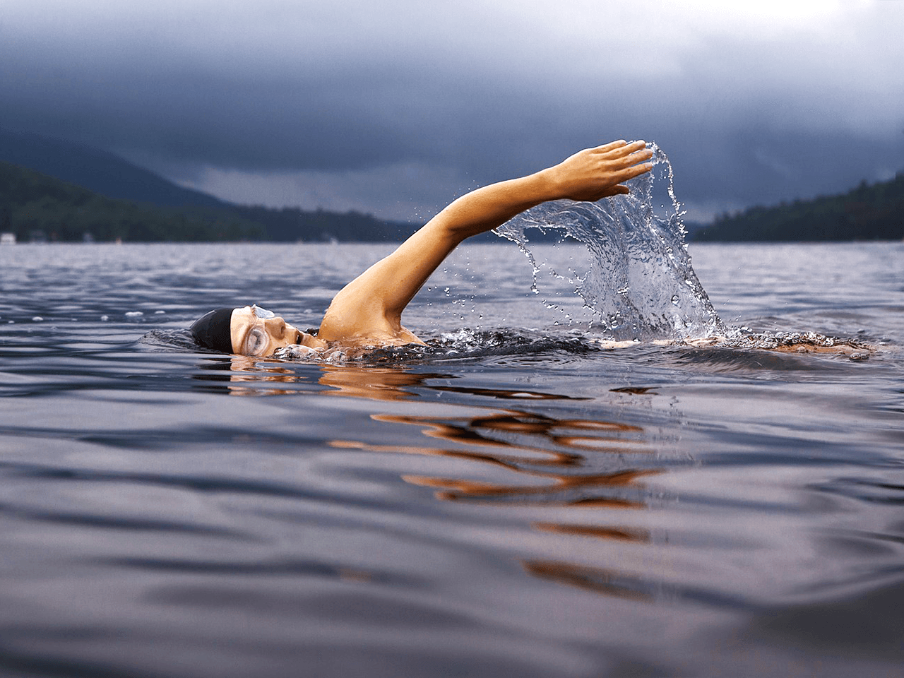 Athlete swimming in a lake