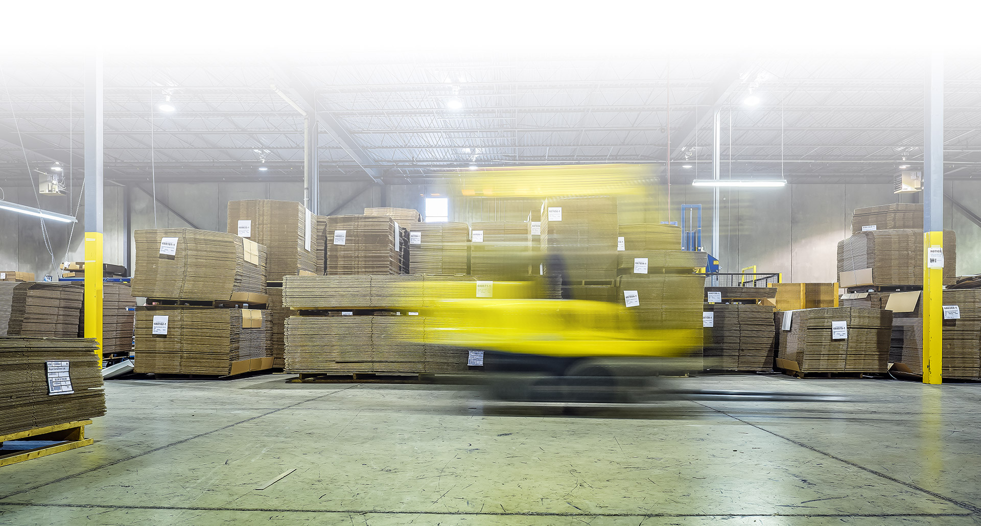 forklift moving fast in a blur